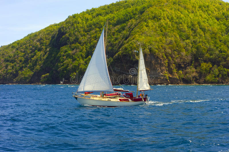 A small ketch sailing in the caribbean royalty free stock photos
