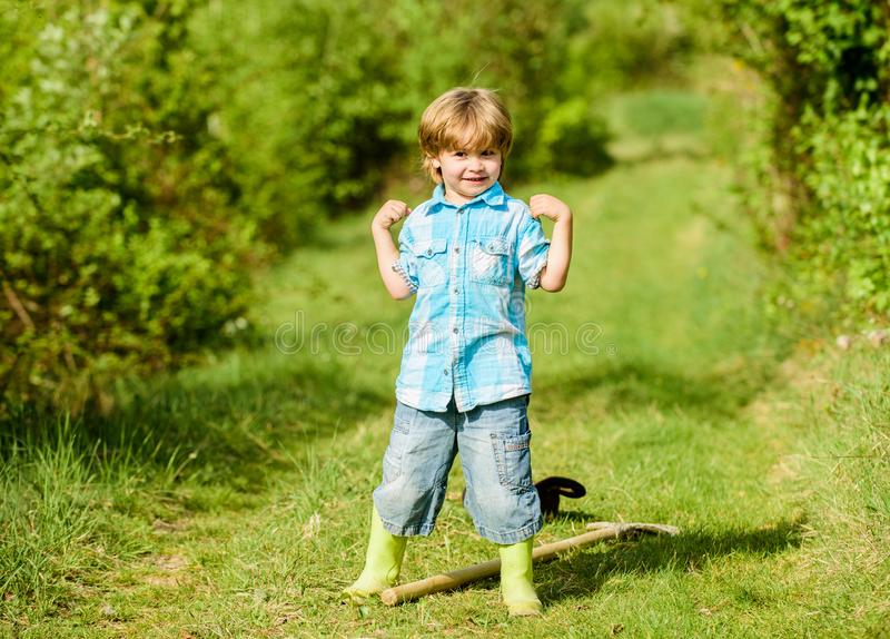 Small kid gardener having fun. human and nature. farming and agriculture cultivation. happy child farmer play with. Garden shovel, spring. earth day. Eco life stock photography