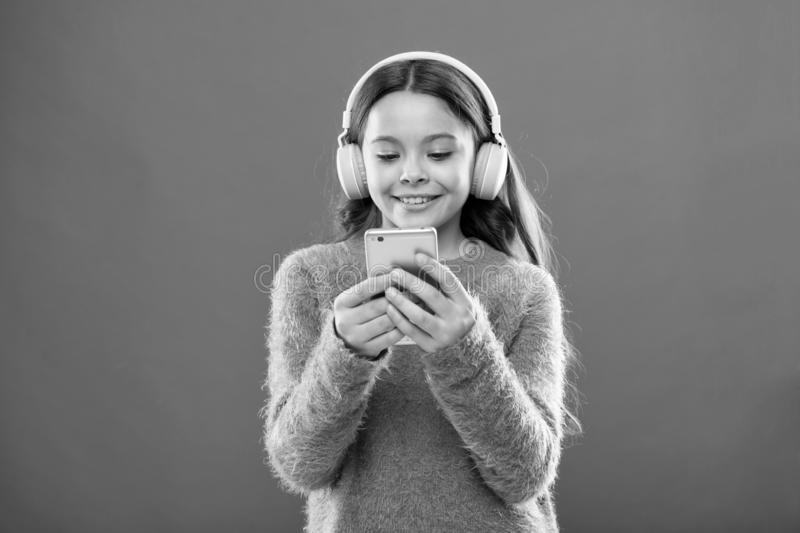 Small kid listen ebook, education. small girl child in headphones. Childhood happiness. Mp3 player. Listen to music. Beauty and fashion. childrens day. Audio royalty free stock photos