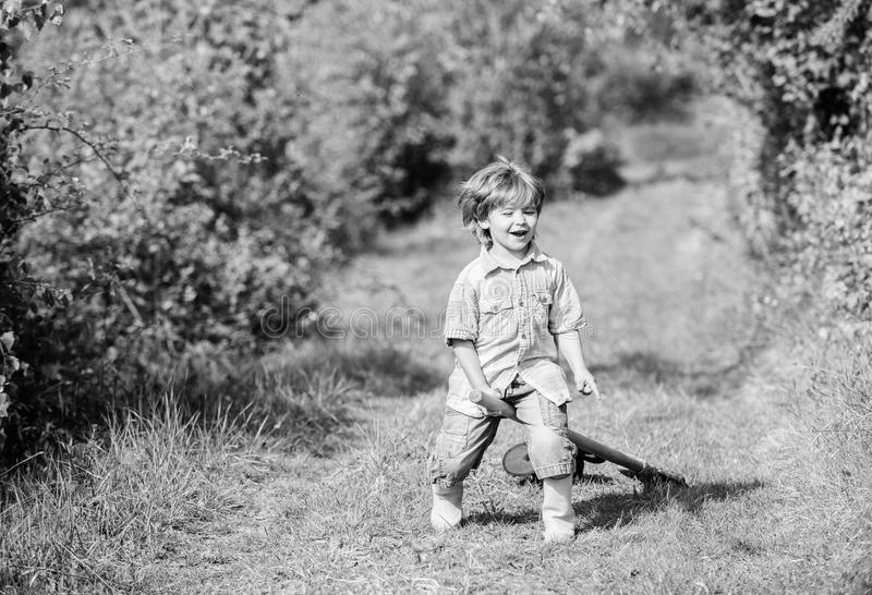 Small kid play with shovel. ecology and environmental protection. earth day. farming equipment. summer fun. happy child. Gardener. spring country side village stock photography