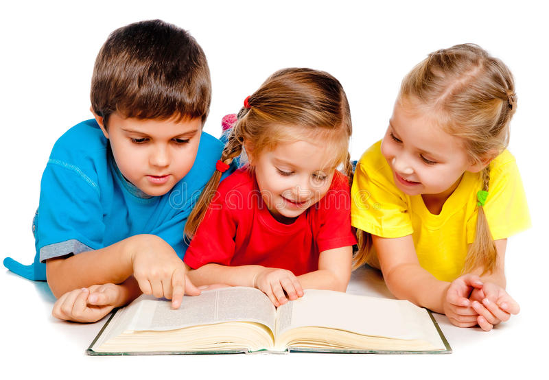 Small kids with a book. Small kids lie on the floor with a book against white stock photo