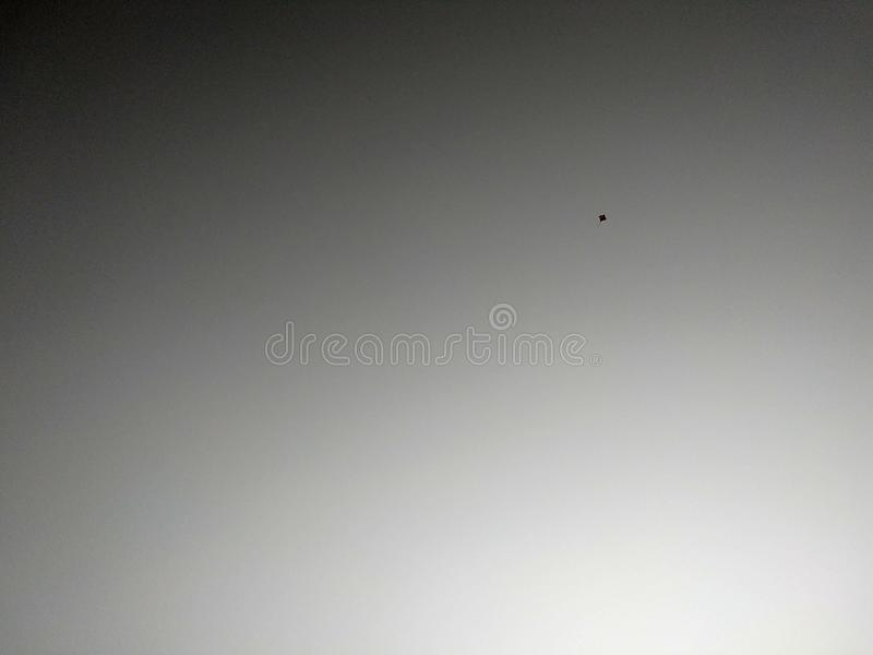 small kite in the black and white sky royalty free stock images