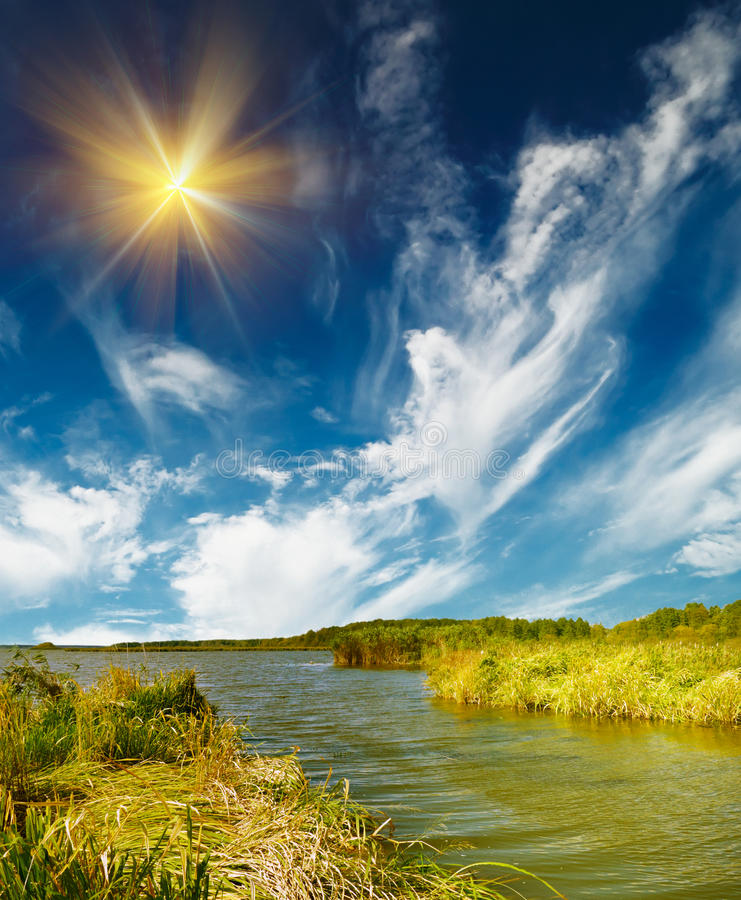 Small lake and blue sky by autumn. royalty free stock photography