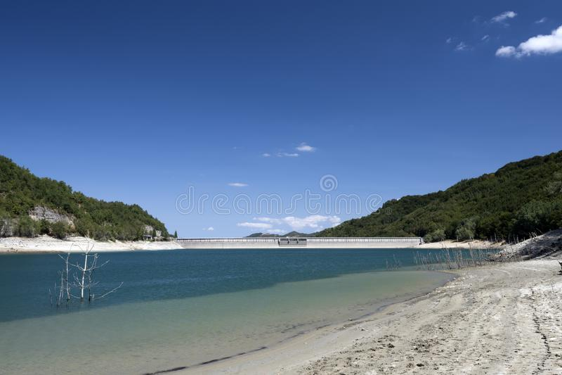 Small mountain lake dam. Small lake landscape with small dam royalty free stock photography