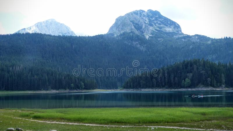 Small lake of mountain after the rain in the natural park of the Durmitor in Montenegro. Travel destination. Summertime and holidaytime. Quiet scene. White and stock photography