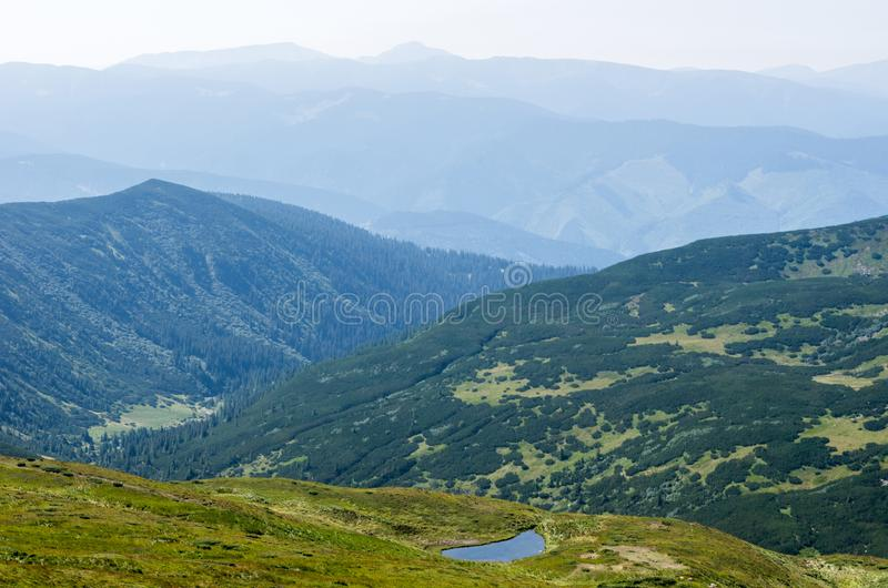A small lake in a mountain range. royalty free stock photo