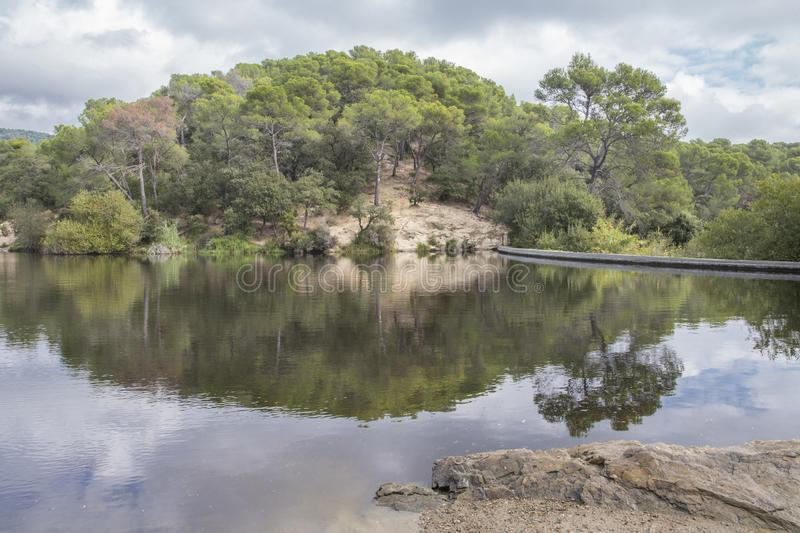 Small Lake in Terrassa, Barcelona, Spain. In a cloudy day royalty free stock photography