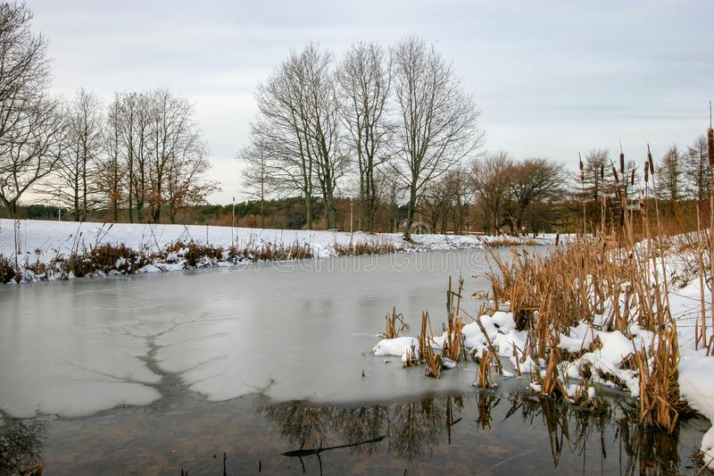 A small lake in winter with ice and water. In the ice channel with water. stock images