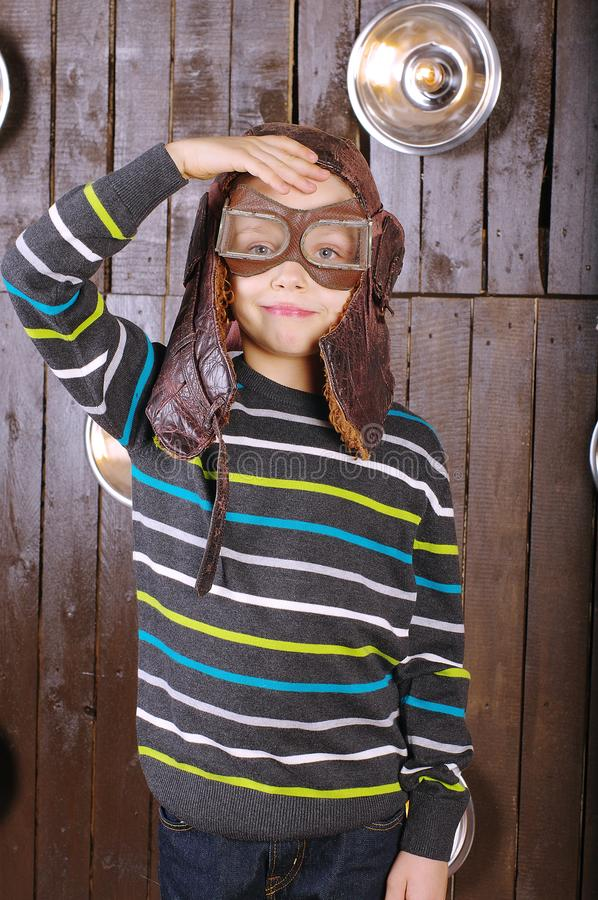 Small laughing boy pilot in glasses royalty free stock photography