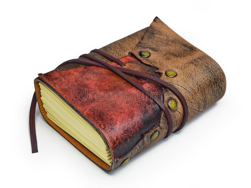 Small leather journal with two different leather colors lay down to the table. Small leather journal with two different leather colors, strap and the metal royalty free stock photography