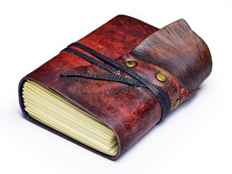 Small leather journal with two different leather colors lay down to the table. Isolated royalty free stock photography