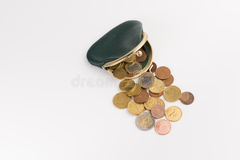 Small leather wallet with coins isolated on white. Background, top view stock photography