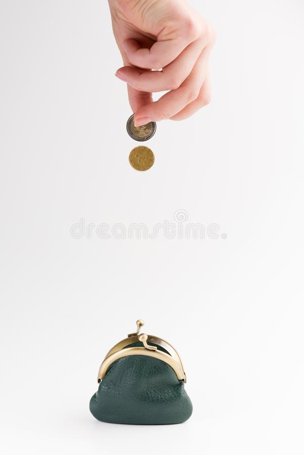 Small leather wallet and hand with gold coins isolated on white. Background royalty free stock images