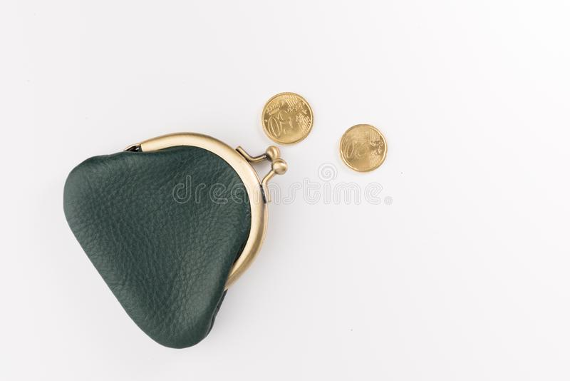 Small leather wallet and hand with gold coins isolated on white. Small leather wallet and two gold coins isolated on white background, top view royalty free stock photos