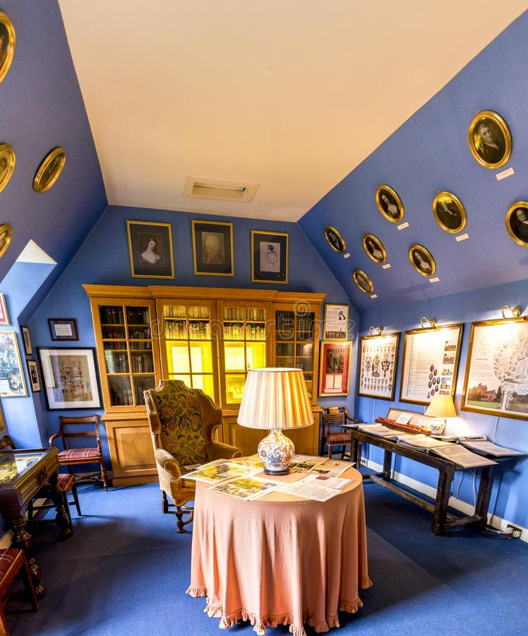 A small library with family portraits on walls in a loft room, Crathes Castle, Scotland stock image