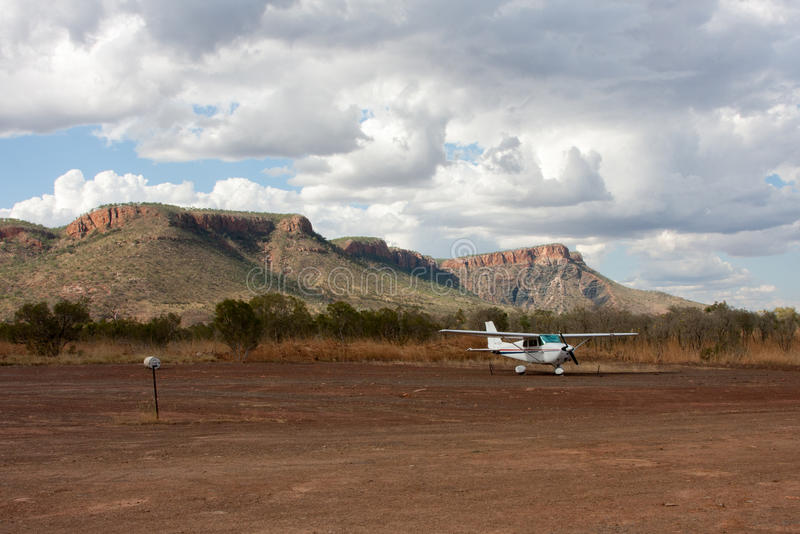 A small light plane parked in The Kimberley, Western Australia. A small light aeroplane parked near the dirt landing strip in the The Kimberley region, Australia stock image