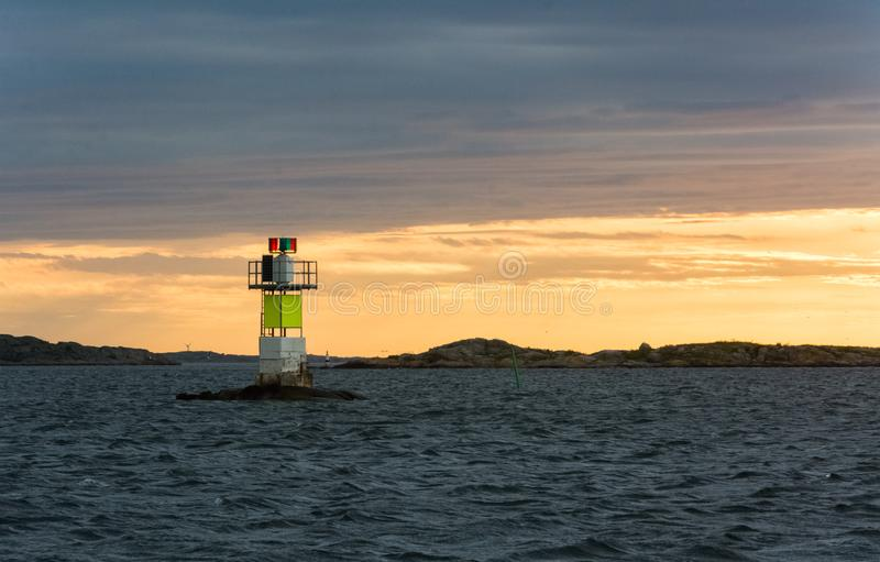 Small light tower in the midde of the sea stock images