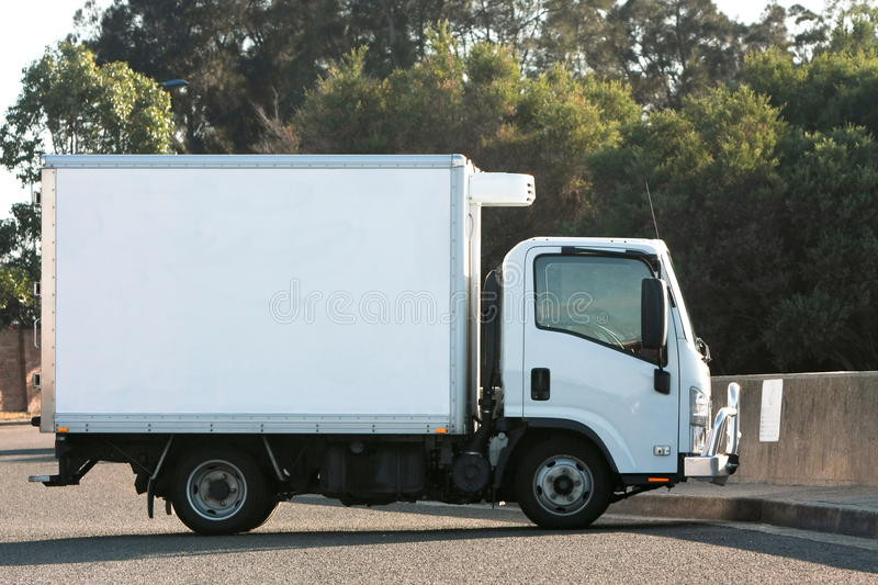 Small light truck with refrigerated container stock images