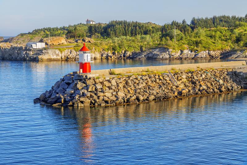 Small lighthouse at norwegian fjord on summer sunny day. stock photos