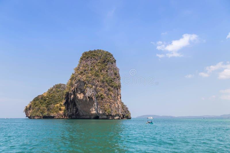 Small limestone island in andaman sea at Railay beach krabi Thailand. In sunny day stock photos