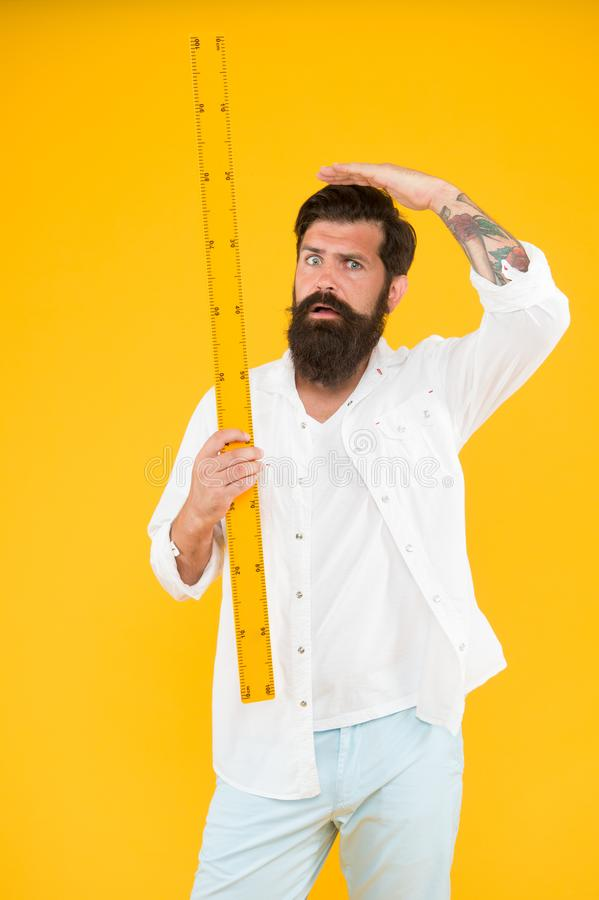 Small little big large. Does size really matter. One meter. Man bearded hipster holding ruler. Measure length. Size tall. And length. Big size. Measure royalty free stock photos