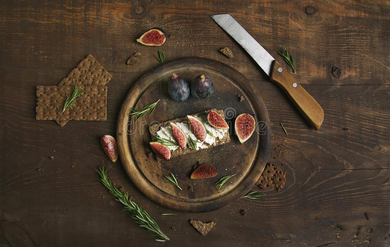 Small loaf of bread with cake cheese, figs and rosemary royalty free stock photo