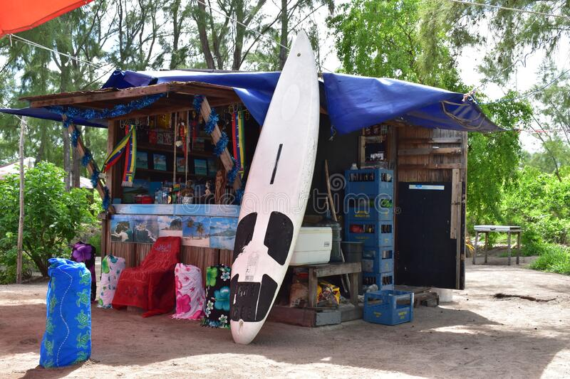 Small local open shop on the beach with large choice of items from Surfboard to rent to clothes and drinks. Small business backgro royalty free stock image