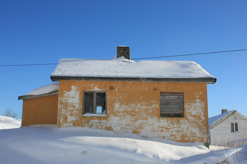 Small Lofoten's house. Covered by snow royalty free stock image