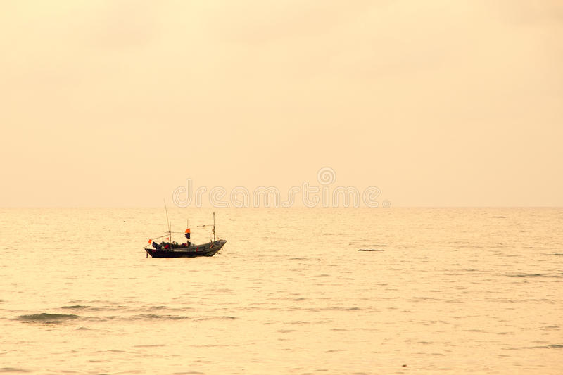 Small lonely fishing boat floating on flat surface of adriatic s royalty free stock image