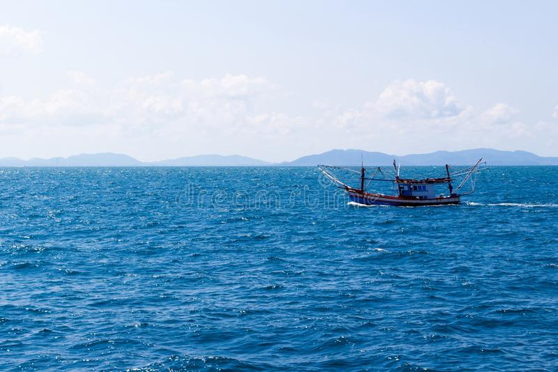 Fisherboat in blue sea royalty free stock photos