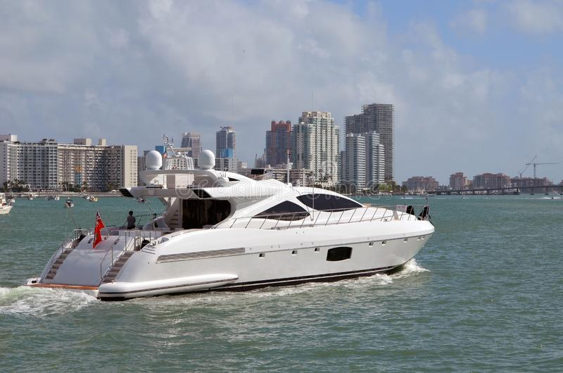 Motor Yacht and Southbeach Skyline. A small luxury motor yacht cruising on the intra-coastal waterway off Miami Beach,Florida with Miami Beach condo skyline in royalty free stock images