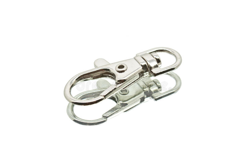 A Small Lying Chrome Carabiner Hook. Small Lying Chrome Carabiner Hook stock photo