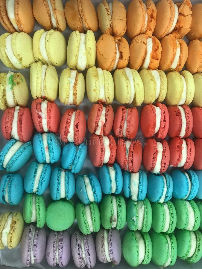 Small macrons, lined up multicolored stock images