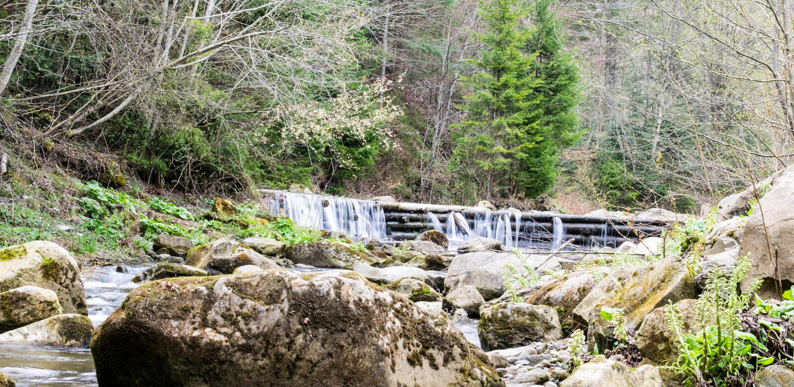 Small man-made waterfall in the Carpathians royalty free stock photo