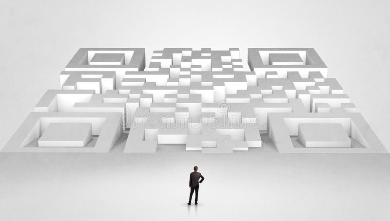 Small man standing in front of a huge maze royalty free stock photos