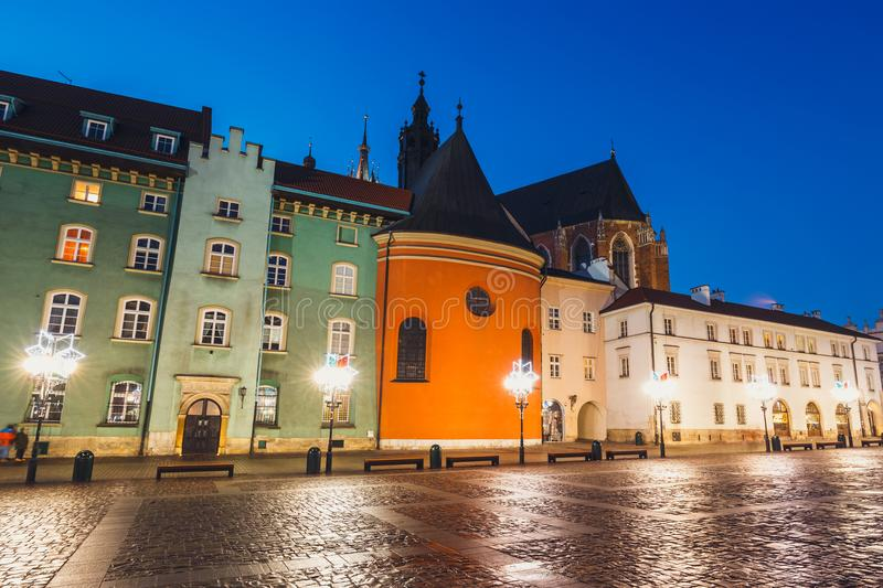 Small market in Krakow, Poland. Old town of Cracow listed as unesco heritage site. Night view of a small market in Krakow, Poland. Old town of Cracow listed as stock photo