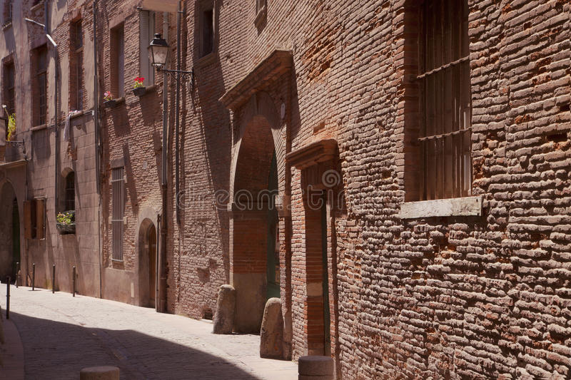Small medieval street in Toulouse & x28;France& x29; royalty free stock image