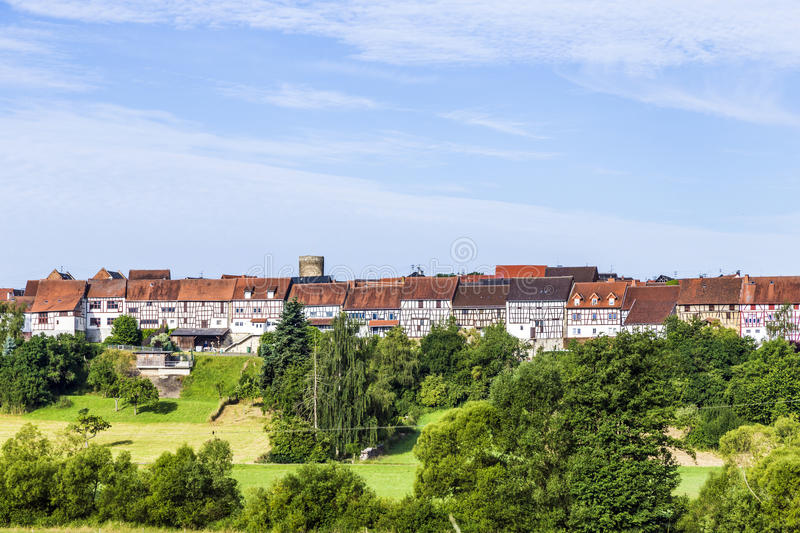 Small medieval town Walsdorf with front of barns. View to the medieval town Walsdorf (Idstein) with the front of barns in morning light royalty free stock photo