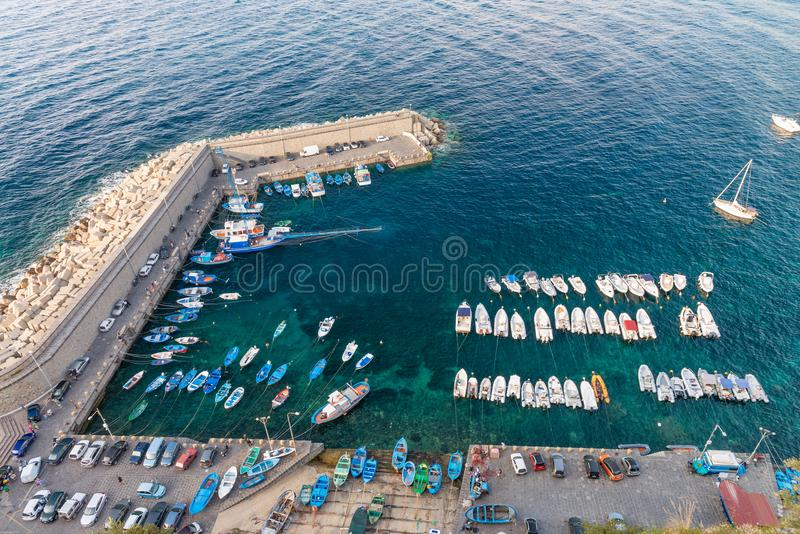 Small mediterranean port with docked boats, aerial view.  royalty free stock image