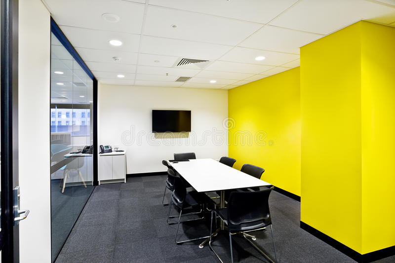 Small Meeting Room With Yellow Walls And Tv Stock Photo - Image of ...