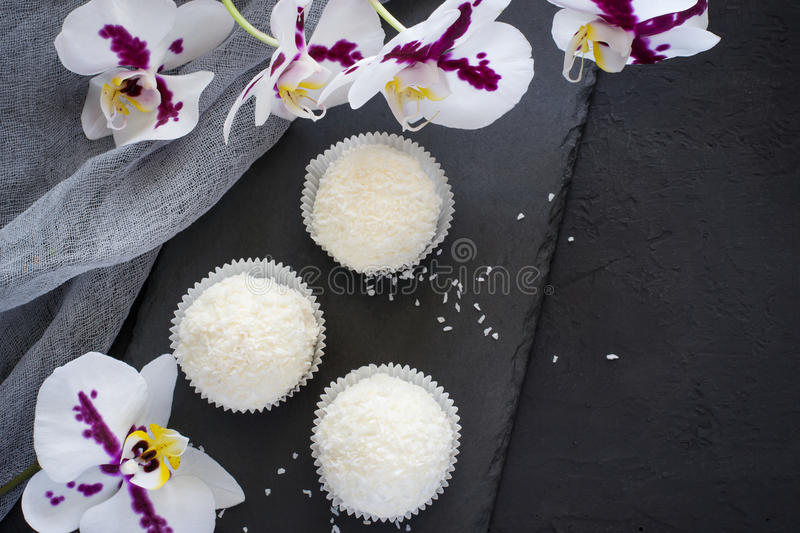 Small meringue cakes Pavlova with glaze and coconut. Top view wi. Th copy space stock photo