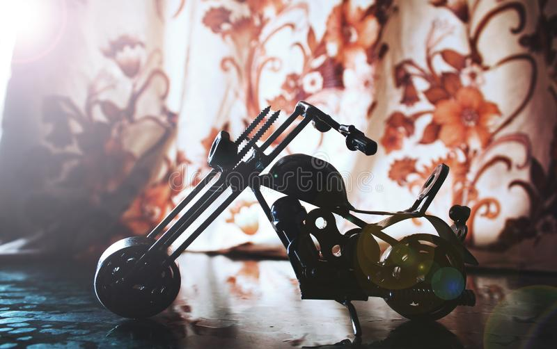 Small Metal motorbike made out of scrap metal pieces stock image