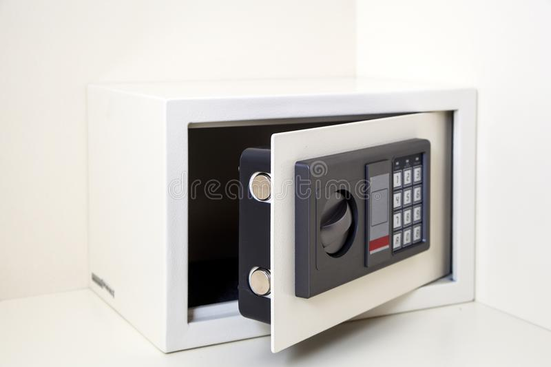 Small metalic white safe stock photo