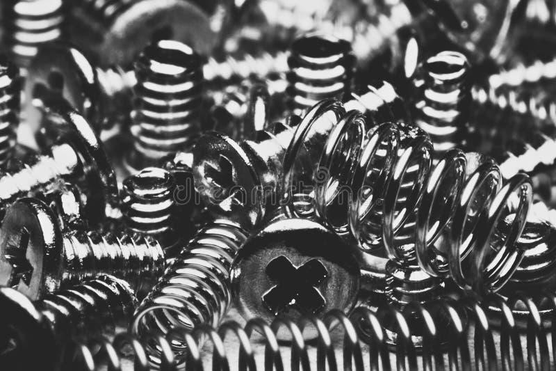 Small metallic things. Macro photo. Black and white stock photo