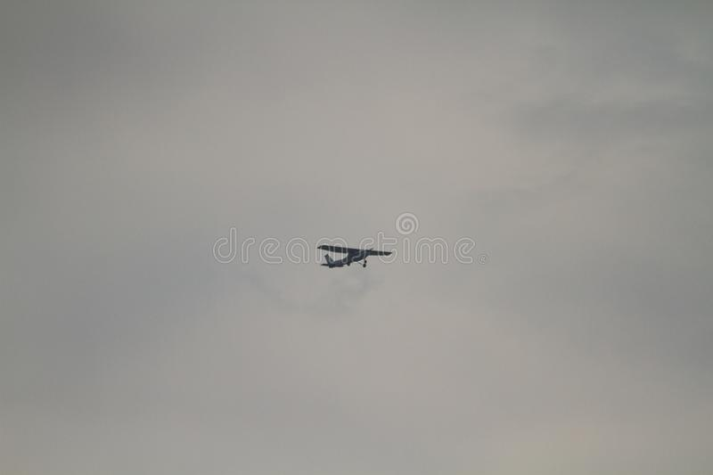 A small microlight training cesna air craft in thr colorful cloudy orange sky royalty free stock image