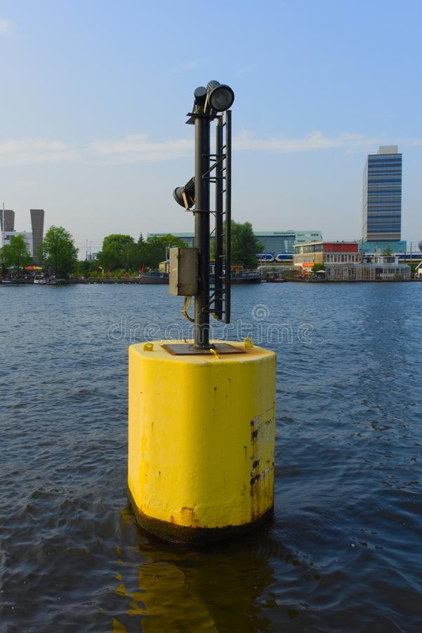 A small mini light tower in the canal of a amsterdam stock photography