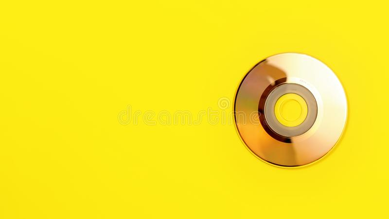 Small 80mm CD on yellow board photo from above. Banner with space for text left.  royalty free stock images