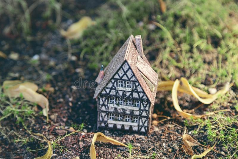 Small model of a half timber house on the ground stock photos