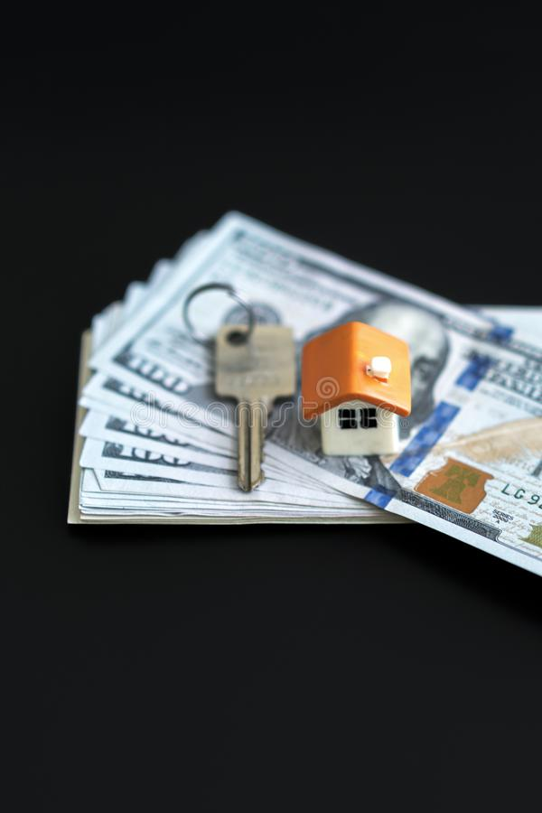 Small Model House and Keys on Newly Designed U.S. One Hundred Dollar Bills. The keys to the purchased house. Reduced copy of the stock photo
