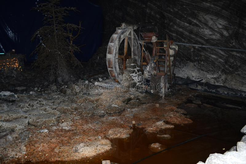 Small model water mill in the ocnele mari salt mine royalty free stock images